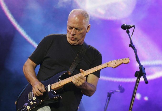"""LONDON - JULY 02: Dave Gilmour from the band Pink Floyd on stage at """"Live 8 London"""" in Hyde Park on July 2, 2005 in London, England. The free concert is one of ten simultaneous international gigs including Philadelphia, Berlin, Rome, Paris, Barrie, Tokyo, Cornwall, Moscow and Johannesburg. The concerts precede the G8 summit (July 6-8) to raising awareness for MAKEpovertyHISTORY. (Photo by MJ Kim/Getty Images)"""